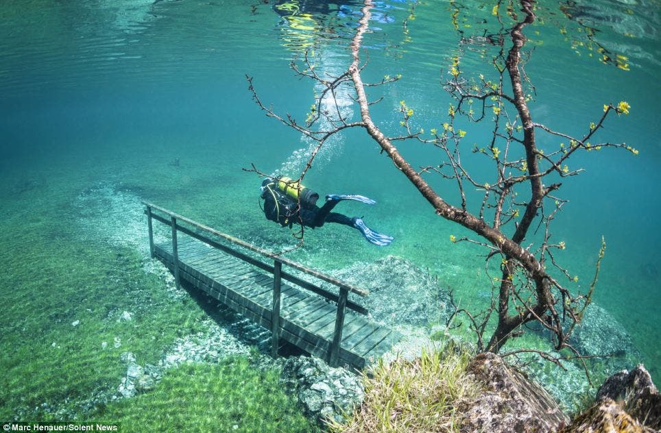 Underwater: This picture shows scuba diver Marc Henauer exploring the beautiful Green Lake in Tragoess, Austria, which floods every year Source: Daily Mail