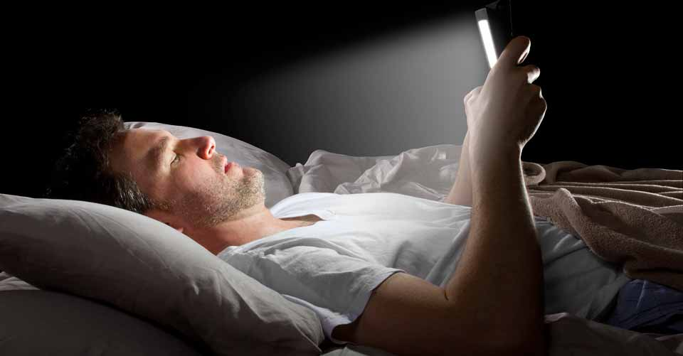 How checking your cellphone before you go to bed can seriously damage your health